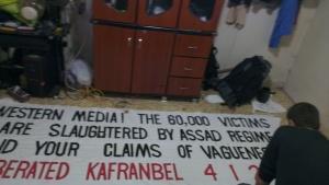 Raed Fares preparing Kafranbel famous banners.